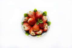 Bowl with cut strawberries Stock Photography