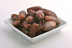 Bowl of dates. Plenty of dates arranged in a white bowl Royalty Free Stock Image