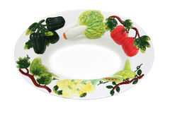 Bowl Decorated with Vegetables. Close-up of white ceramic bowl decorated with a ring of vegetables. Shot with Canon 20D royalty free stock photography