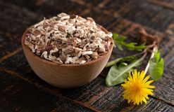 Bowl of Dehydrated Dandelion Root on a Rustic Wooden Table. A Bowl of Dehydrated Dandelion Root on a Rustic Wooden Table stock photography
