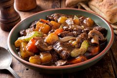 Hearty Homemade Beef Stew. A bowl of delcious hearty homemade beef stew with potato, turnip, carrot, celery, mushroom and onion royalty free stock photography