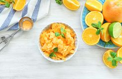Bowl with delicious citrus ice cream. On wooden kitchen table Royalty Free Stock Image