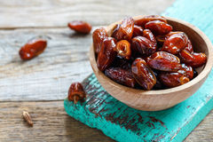Bowl with delicious dried dates. stock photo
