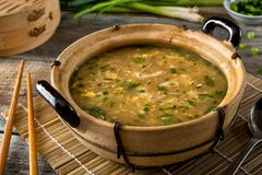 Egg Drop Soup. A bowl of delicious egg drop soup with green onion garnish Royalty Free Stock Images