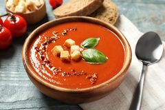 Bowl with delicious fresh homemade tomato soup. On table stock images
