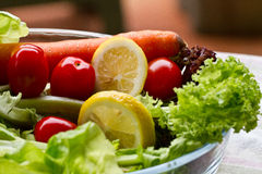 Healthy Food. A bowl of delicious and healthy food consist of vegetables and lemon royalty free stock photos