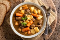Hearty Beef Stew. A bowl of delicious homemade beef stew with carrots, potato, onion and turnip royalty free stock image