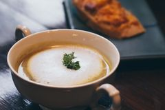 A bowl of delicious homemade cream of mushroom soup background stock images