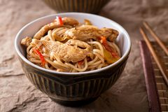 Honey Garlic Noodles. A bowl of delicious honey garlic noodles with chicken and peppers stock images