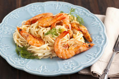 A bowl of delicious prawns spaghetti with creamy sauce Stock Images