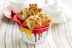 Bowl with delicious sweet fresh buns muffins Royalty Free Stock Images