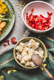 Bowl of Diced feta cheese marinated in olives oil and spoon, top view Royalty Free Stock Photography