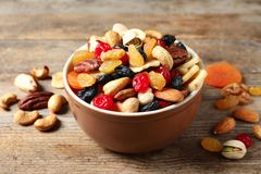Bowl with different dried fruits and nuts. On table stock photography