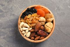 Bowl with different dried fruits and nuts on table. Top view stock photo