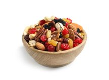 Bowl with different dried fruits and nuts on white. Background royalty free stock images