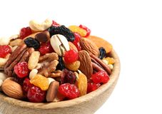 Bowl with different dried fruits and nuts on white background, closeup. stock photos
