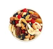 Bowl with different dried fruits and nuts on white, top view. Bowl with different dried ts and nuts on white background, top view stock image