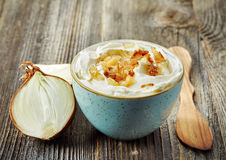 Bowl of dip sauce with caramelized onions Stock Image