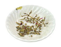 Bowl with discarded grape seeds and stems. A small bowl used for discarded grape seeds and stems from seeded grapes Royalty Free Stock Photo