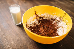 Bowl with dough, chocolate powder, glass of milk Royalty Free Stock Photos