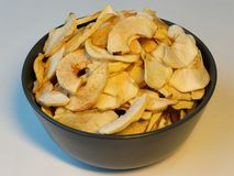 Bowl of dried apples. Bowl of homemade dried apples royalty free stock images