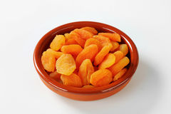 Bowl of dried apricots Stock Photos
