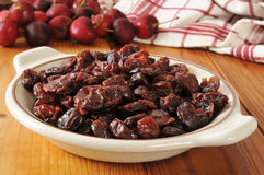 Bowl of dried cherries. A bowl of dried organic cherries on a wooden table Royalty Free Stock Photo