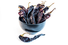 Bowl of Dried Chili (Chile) Guajillo Chili. Collection of dried chili pods Stock Image
