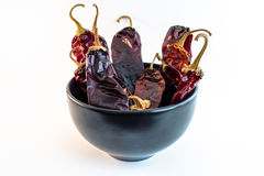 Bowl of Dried Chili (Chile) Peppers. Collection of dried chili pods Royalty Free Stock Photos