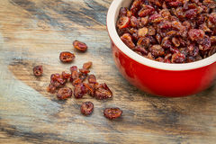Bowl of dried cranberries Stock Photos