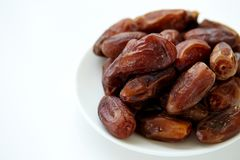 Bowl of dried dates isolated on white backgroun Stock Photography