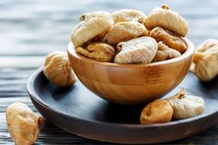 Sweet dried figs in a wooden bowl. Royalty Free Stock Images