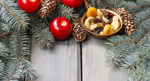 Bowl of dried fruits among fir branches Royalty Free Stock Photo