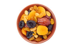 Bowl of dried fruits mix on white Stock Photos
