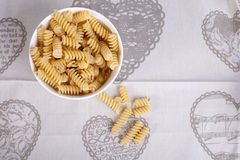 Bowl of dried fusilli pasta. White bowl of dried fusilli pasta Stock Photos