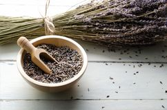 Tied Bunch of Dried Lavender Stems with Bowl of Buds on Wood Planked Table stock photography