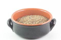 Bowl of dried lentils on white background Royalty Free Stock Photography