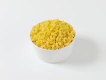 Bowl of dried macaroni Stock Photos