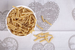 Bowl of dried macaroni pasta. White bowl of dried macaroni pasta Stock Photos