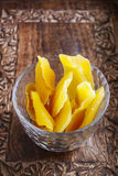 Bowl of dried mango fruits on wooden table Royalty Free Stock Photo