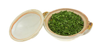 Bowl of dried parsley flakes with lid Stock Photos