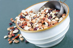 A bowl of dried soup beans with a scoop. Stock Image