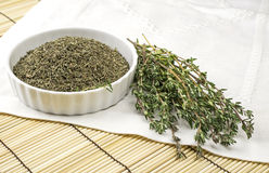 Bowl with dried thyme Stock Photo