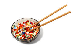 Bowl with drugs and chopsticks Stock Photo