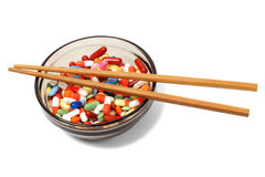 Bowl with drugs and chopsticks Royalty Free Stock Images