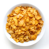 Bowl of dry cornflakes isolated on white. Royalty Free Stock Photos