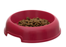 Bowl of dry dog food, kibble, isolated over white Stock Photo