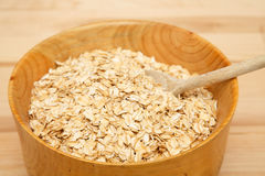 Bowl of Dry Oats with Wood Spoon Stock Photography
