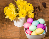 Bowl of dyed eggs with vase of flowers Royalty Free Stock Images
