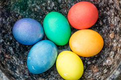 Bowl with dyed hard boiled eggs Stock Photos